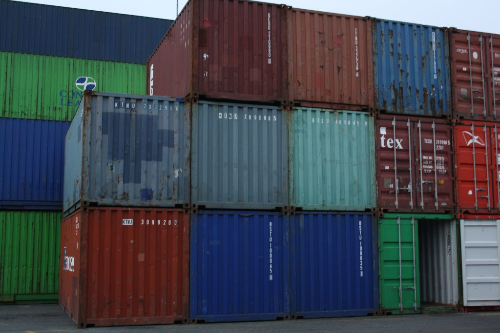 An image of shipping containers at a port in Dublin, piled four containers high.
