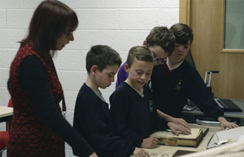 School children looking at archives and rare books