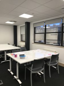 A photo of a highly configurable room for teaching, training and personal development.