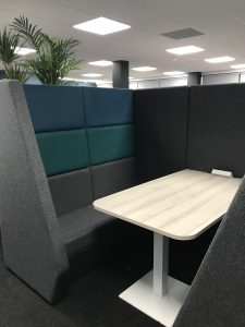 A photo of an acoutcially baffled break out booth with sofas and a table forinformal meetings up up to 6 people.