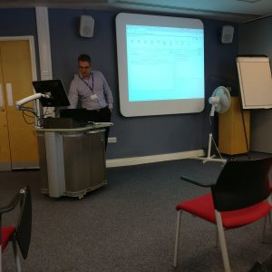 A picture of John Moss presenting to the group