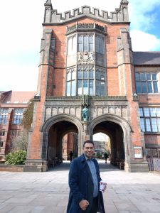 Dr Hassan Karali in front of the arches