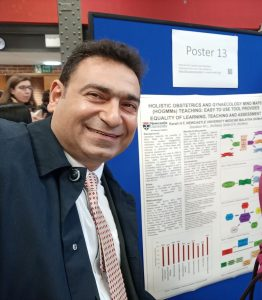 Dr Hassan Karali in front of his poster