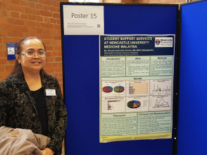 Brenda Pancho standing in front of her poster presentation