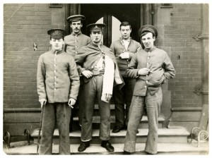 Wounded soldiers in front of the Quadrangle entrance to the Armstrong Building
