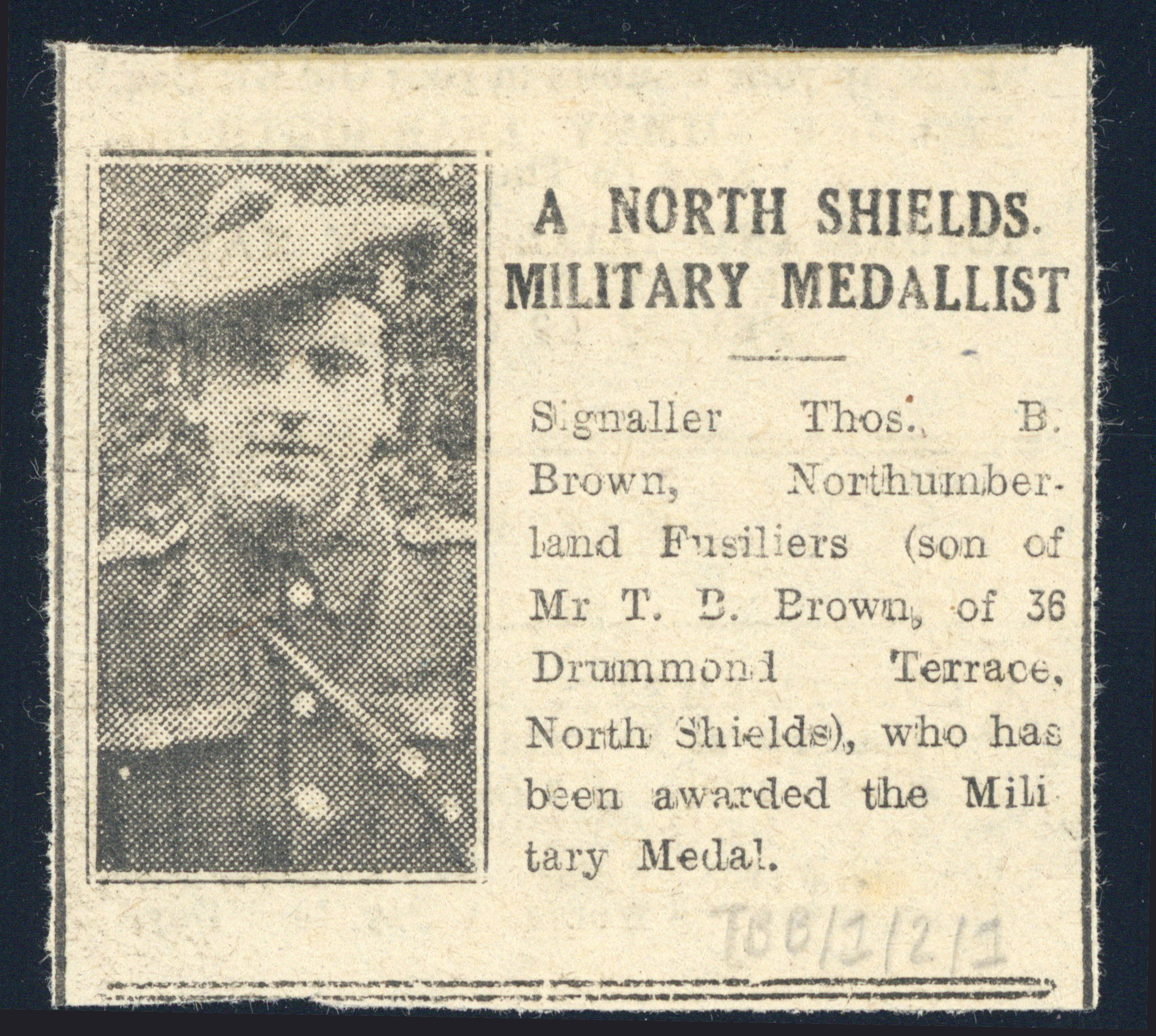 Newspaper cutting of Thomas Baker Brown being awarded a Military Medal