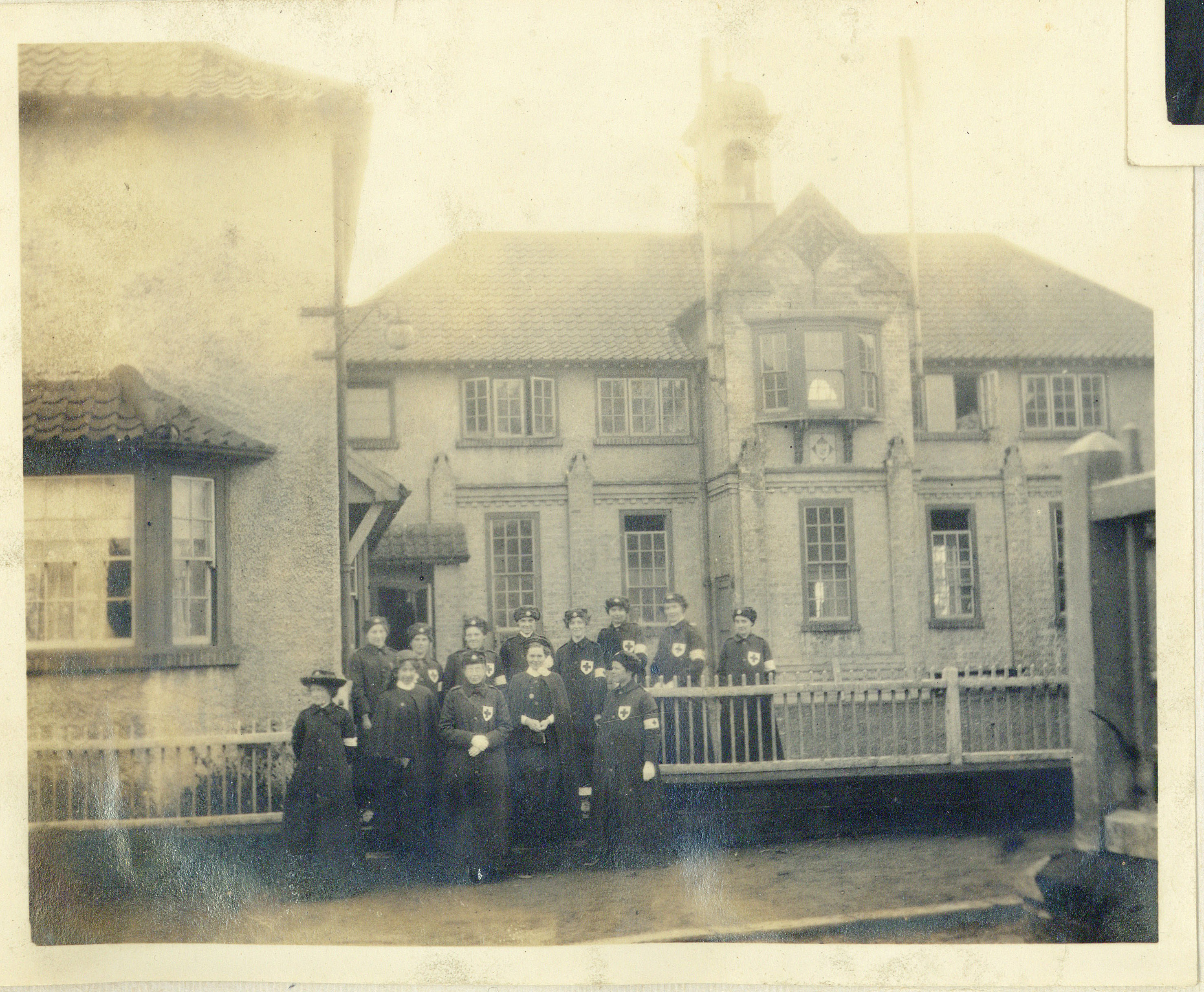 Photograph of nurses outside the auxiliary Hospital at Rounton Grange, New Years Eve, 1916 (Charles Philips Trevelyan Archive, CPT/PA/6)