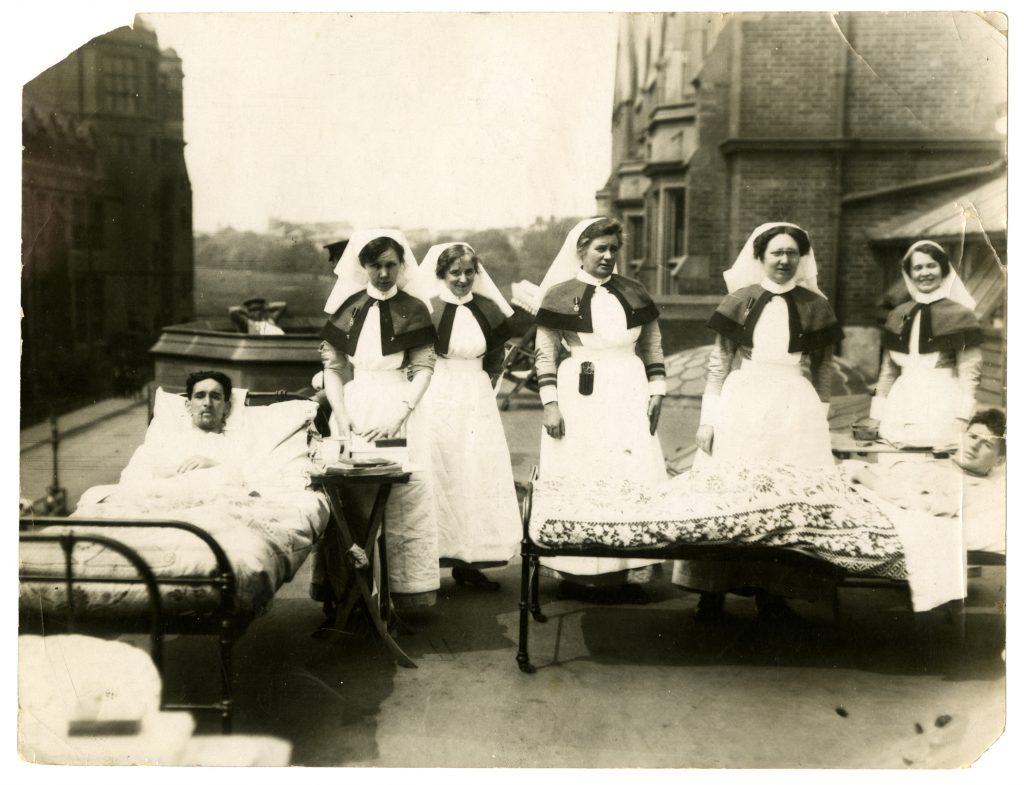 Black and white image of nurses and patients on a roof top