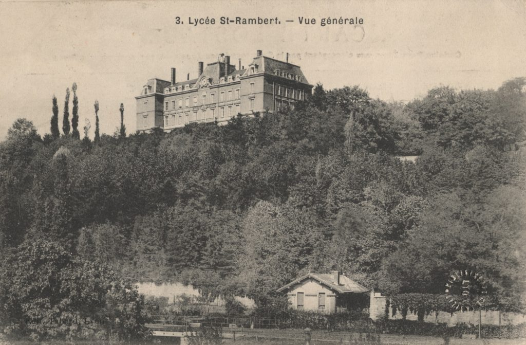 Black and white postcard showing a large building on a hill