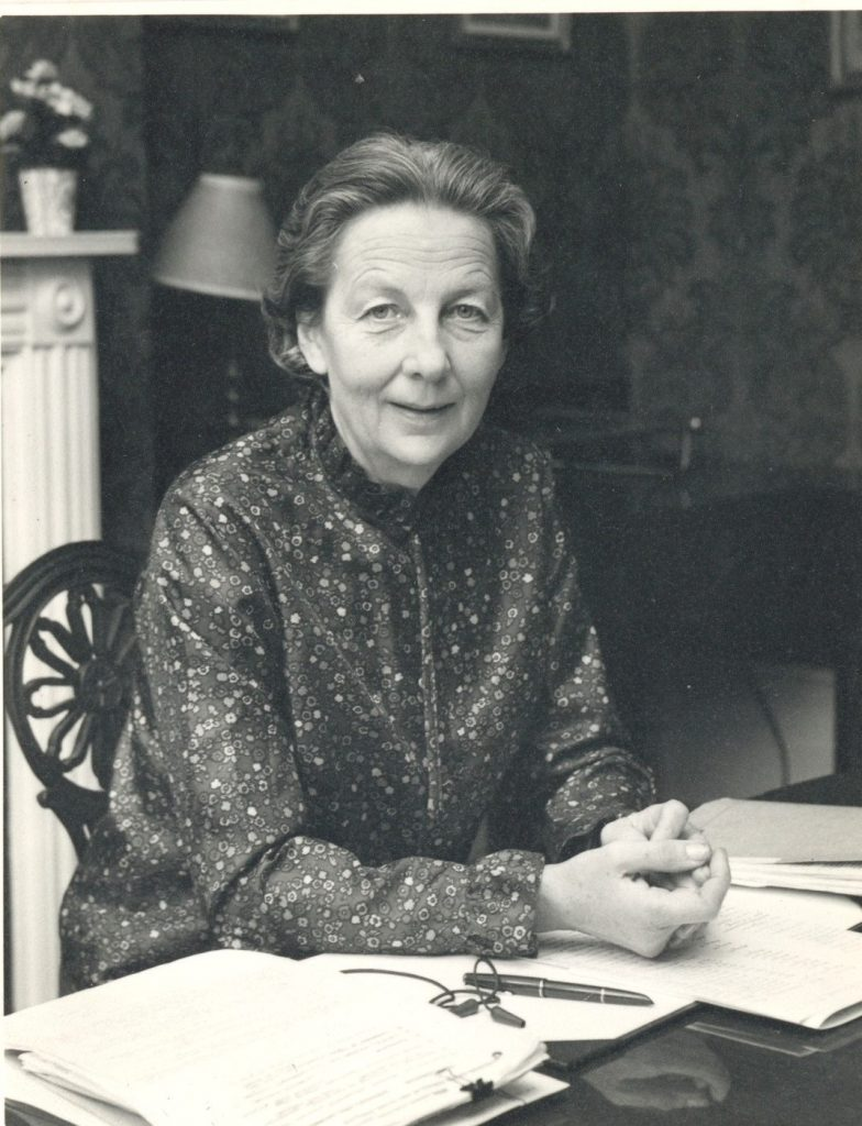 Photograph of Lady Plowden at her desk