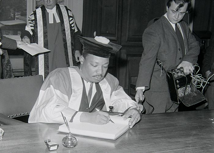 Photograph of Martin Luther King signing the University's visitors' book, 13 November 1967