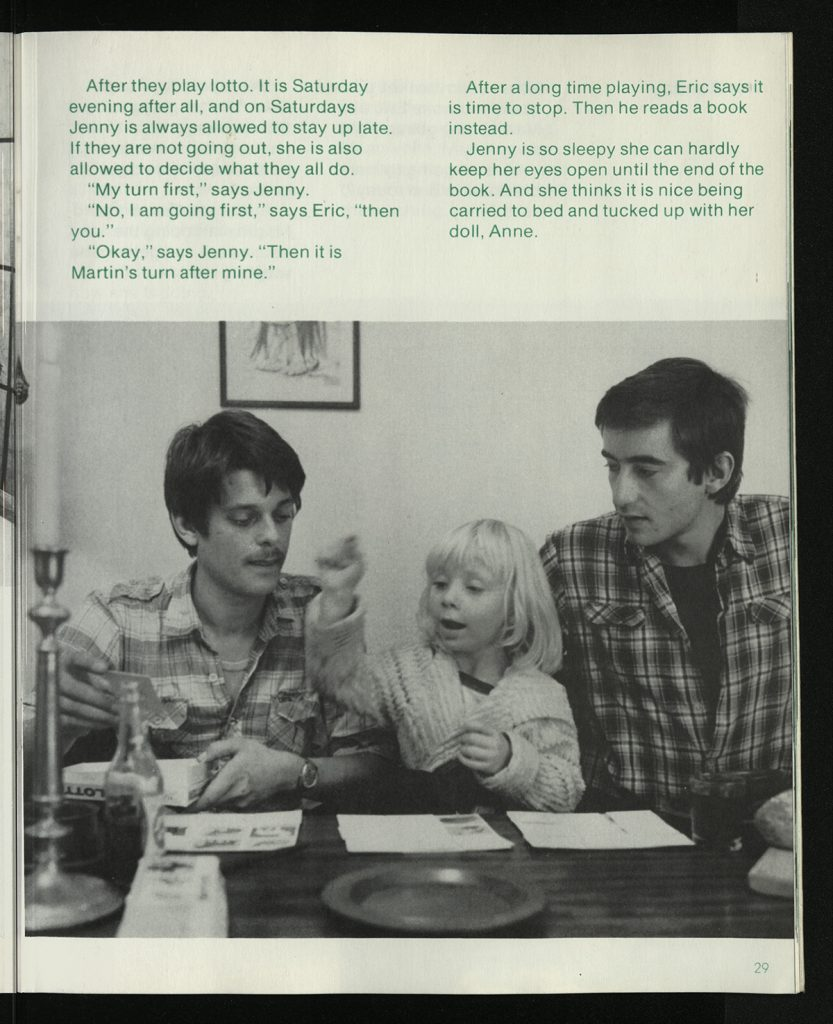 Page 29 of Jenny Lives With Eric and Martin containing text from the story and a photograph showing a young girl sat between two men at a table.