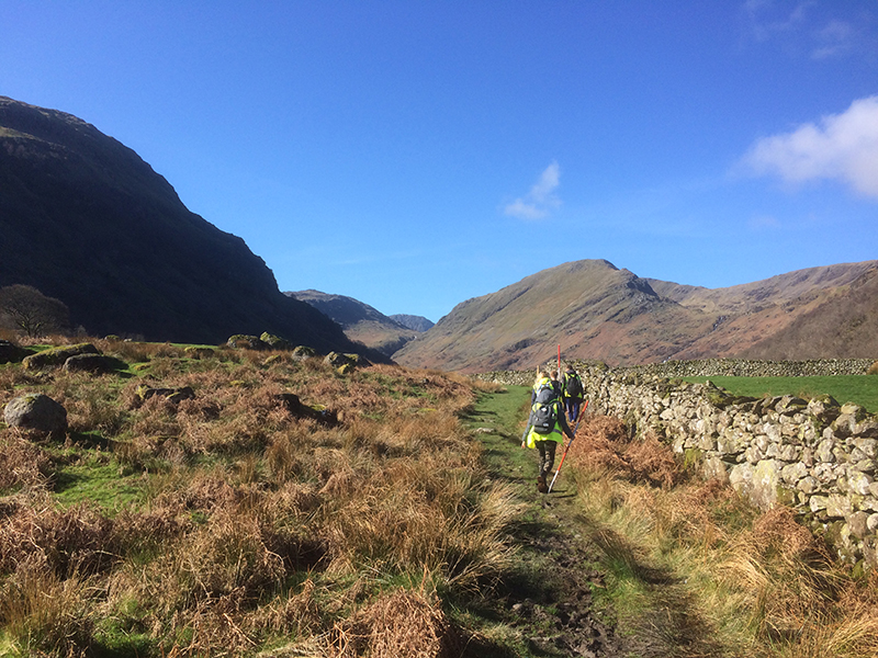 Geomatic students walking in the Seathwaite Valley