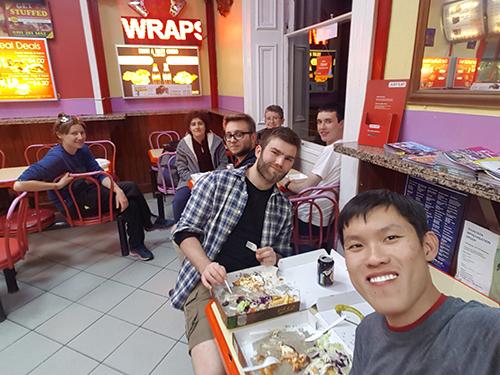 Team enjoying dinner after a work session