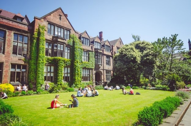 Image showing students on the grass in the old Quad outside the Architecture building.
