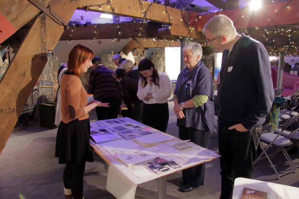 Seven Stories' Collections Assistant Danielle McAloon talks to visitors. Image: Newcastle University