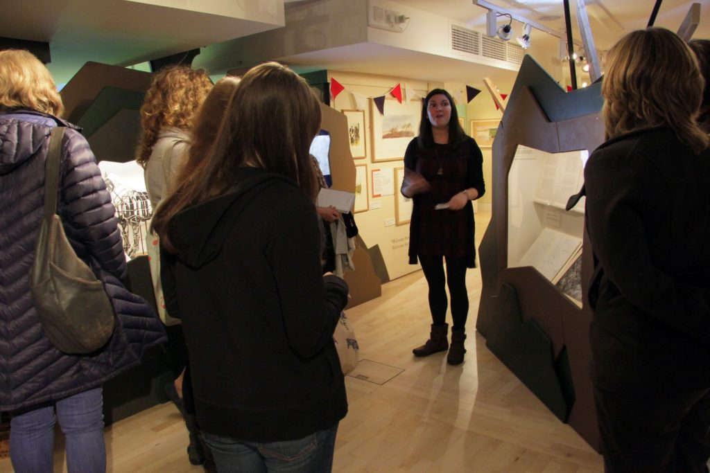 Dr Jessica Medhurst giving a guided tour of the Michael Morpurgo: A Lifetime in Stories exhibition. Image: Newcastle University