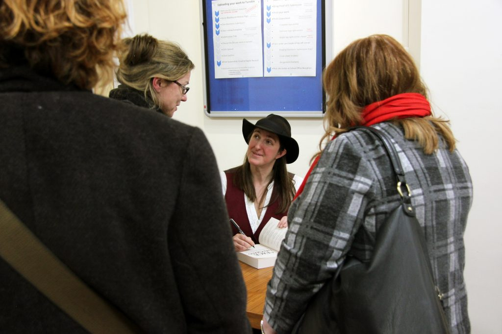 Frances Hardinge signs books after her talk. Image: Newcastle University
