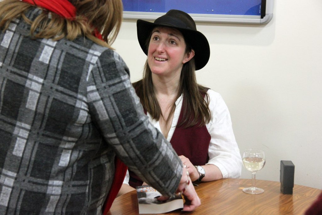 Frances Hardinge signs copies of her books. Image: Newcastle University
