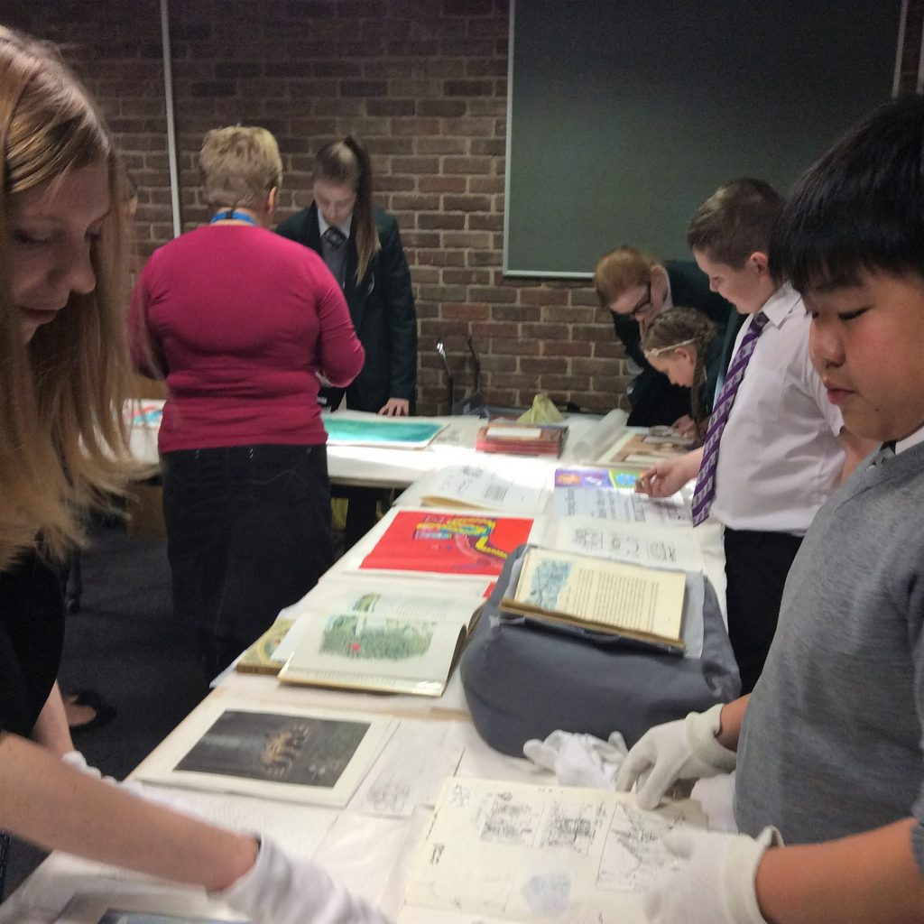 The children used white gloves to explore the Seven Stories Collection. Image: Newcastle University