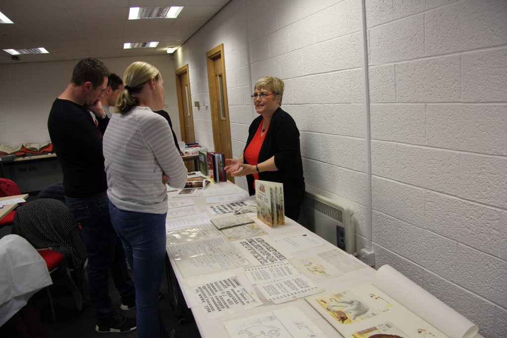Teachers exploring Seven Stories' alphabet books with Collections Officer Paula Wride. Image: Newcastle University