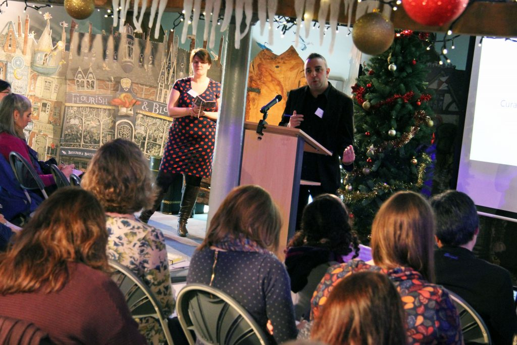 Jake Hope speaking about children's literature prizes, chaired by Dr Lucy Pearson.