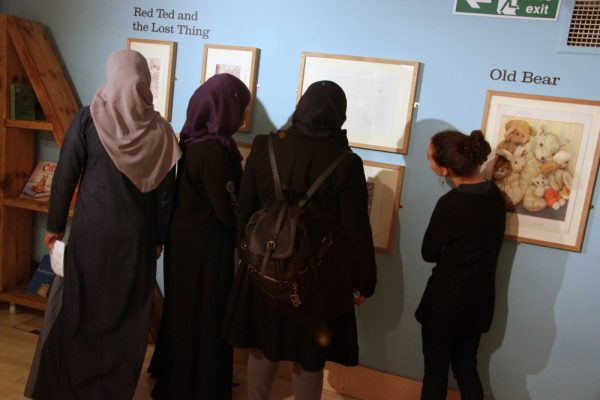 Participants in Northumbria University, Tyne and Wear Archives and Museums and Seven Stories' MUPI-funded project, A Taste of Home, explore the Bears exhibition at Seven Stories.
