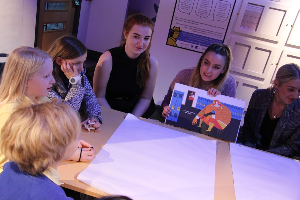 Students reading stories to the children from Hotspur Primary School. Image: Newcastle University