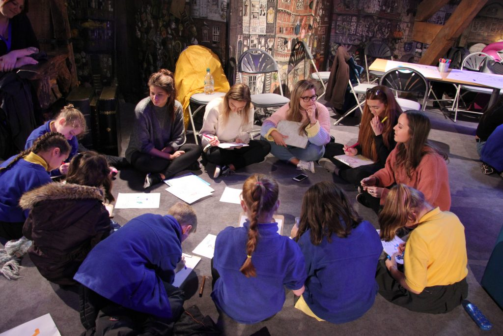 The students leading their session with children from Hotspur Primary School at Seven Stories. Image: Newcastle University