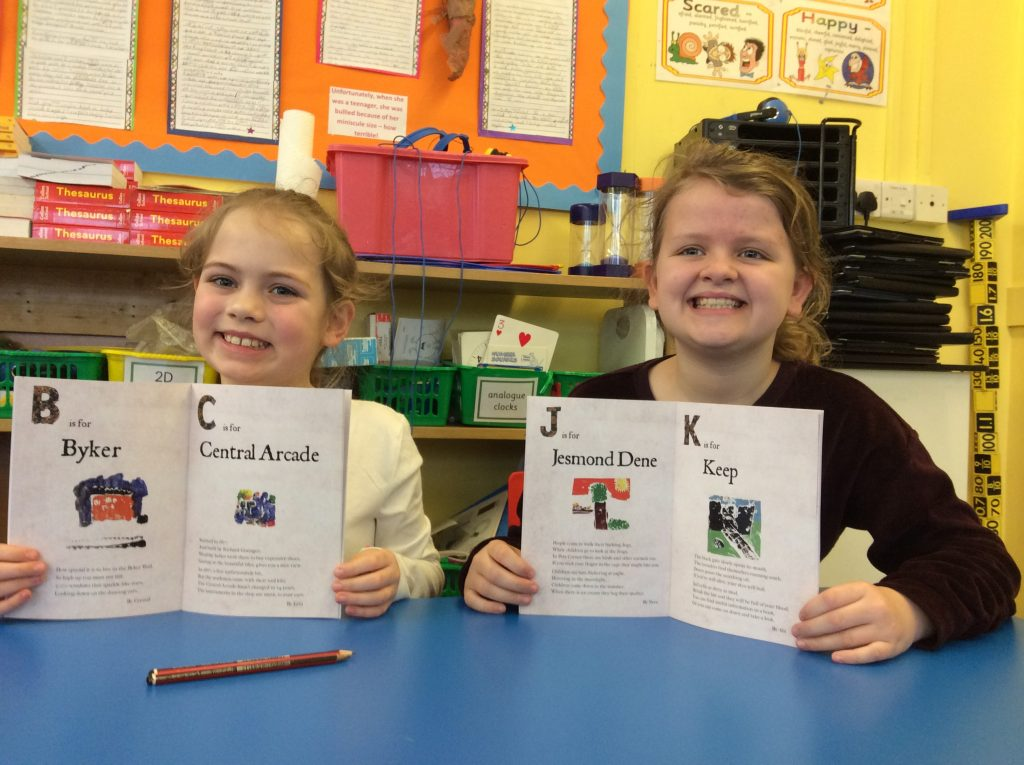Children with their finished alphabet books.