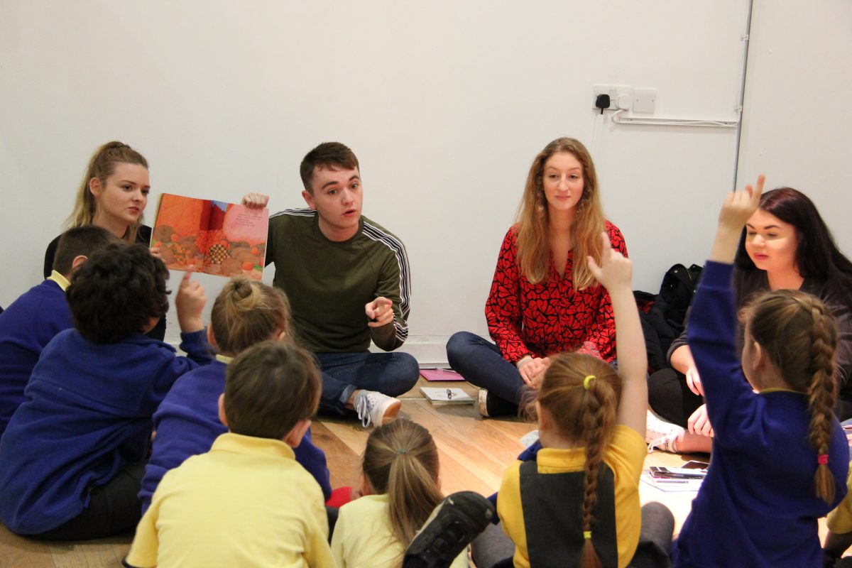 Geographies of Gender and Generation students discuss David McKee's books with primary school children. Image: Newcastle University