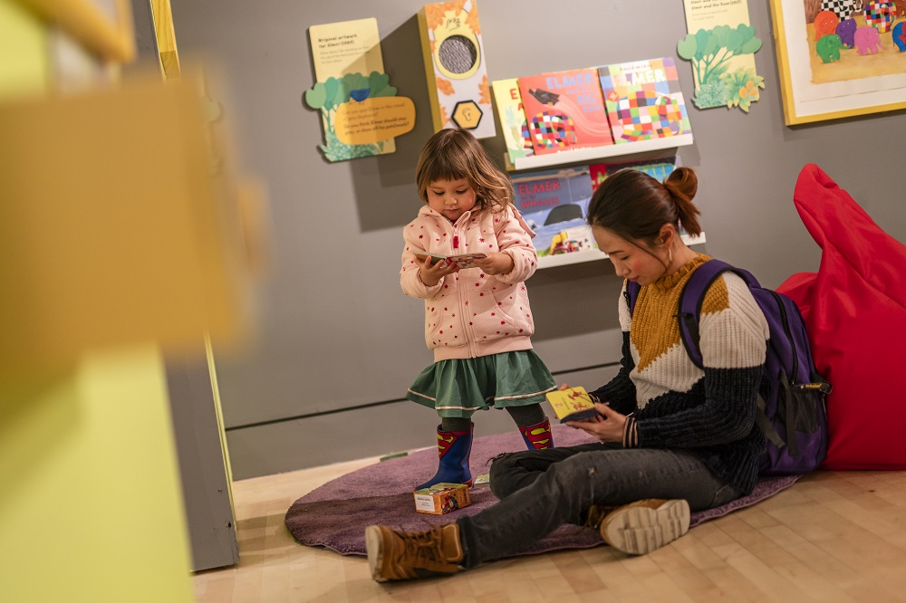 A family explores the Elmer and Friends exhibition. Image: Seven Stories, The National Centre for Children's Books