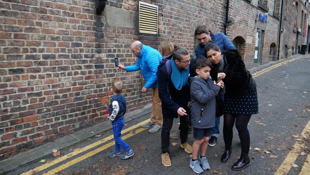Families explore the Magical Reality app in the Ouseburn Valley, Newcastle. Image: Newcastle University