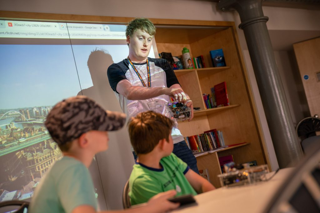 PhD researcher Sean Peacock leads a Sense Explorers workshop. Image: Seven Stories: The National Centre for Children's Books, photography by Richard Kenworthy